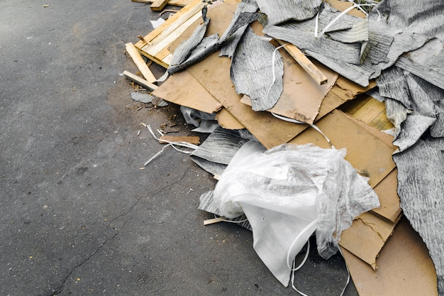 Construction and packaging debris on the pavement.