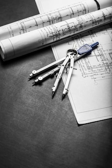Construction planning drawings on black