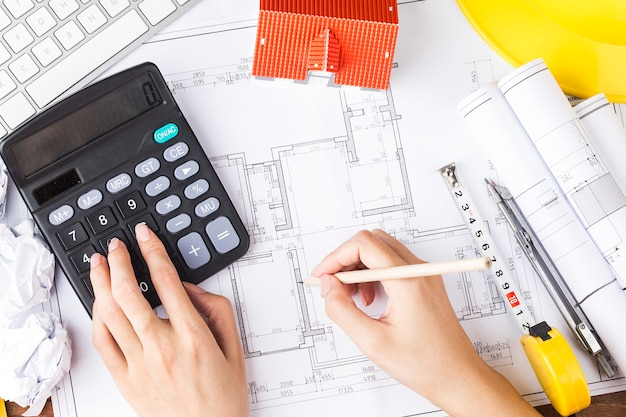 Construction planning with construction drawings and accessories,construction projects on paper. the concept of architecture,