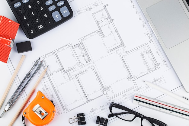 Construction planning with construction drawings and accessories,construction projects on paper