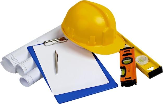 건설 계획, 메모장, 펜, 수준 및 안전 헬멧-절연