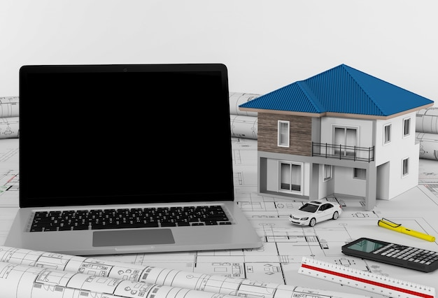 Construction plans with laptop and house, architectural and engineering concept.