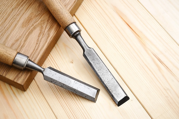 Construction and repair. carpentry. two old chisels on a wooden table