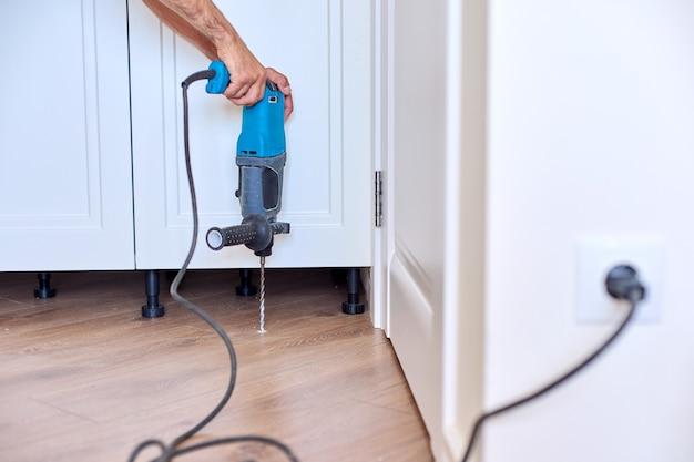 Construction and repair, doorstop, installation of door stop tools, stopper on floor with tool