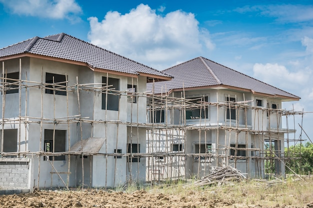 Construction residential new house in progress at building site