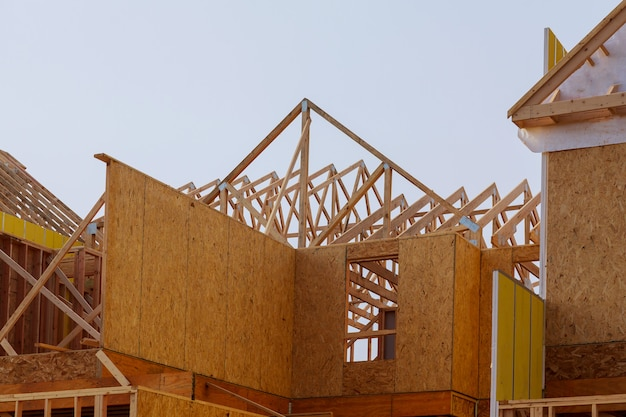 Construction of roof wood frame residential building under construction.