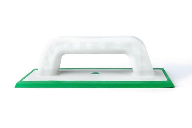 Строительный резиновый шпатель для заполнения швов, изолированные на белом фоне.