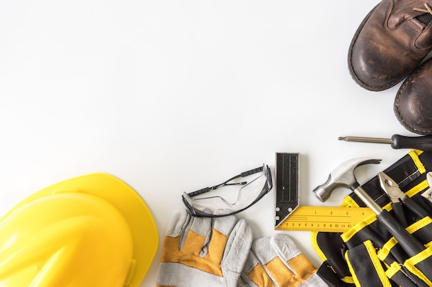 Construction safety equipment and tools on white background.