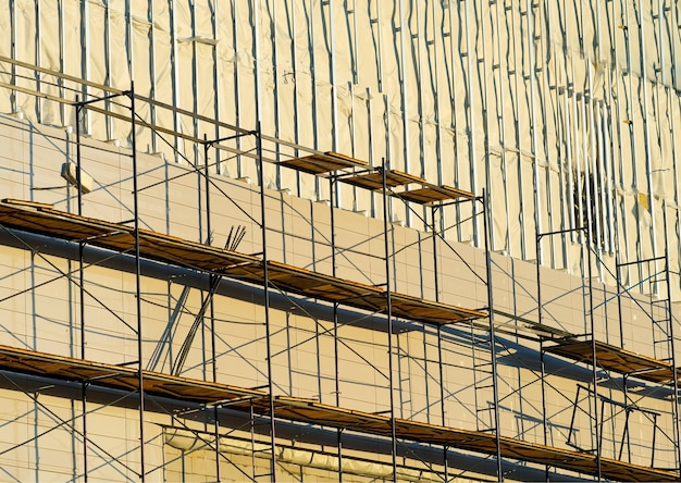 Construction scaffold during sunset time backdrop
