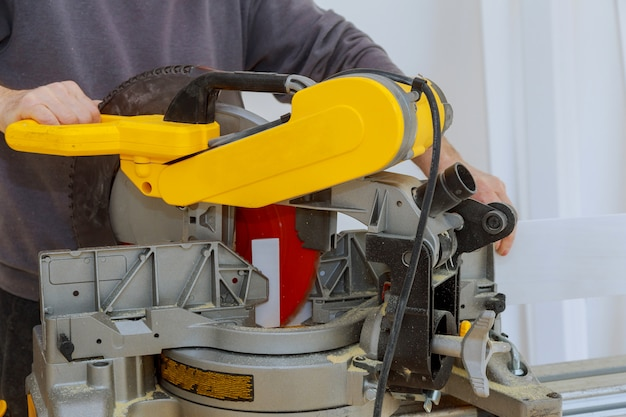 Construction site power tools cutting using circular saw. working equipment carpentry