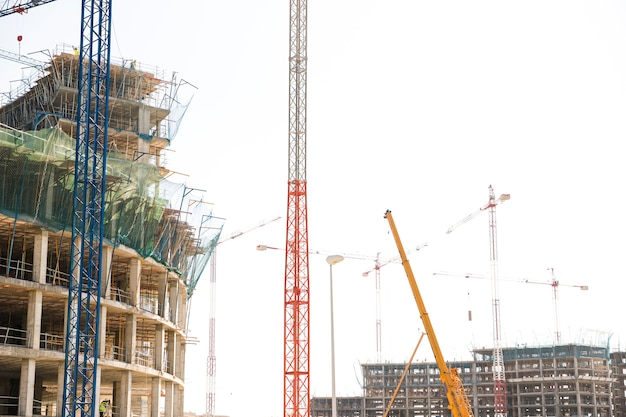 Construction site with cranes and incomplete buildings