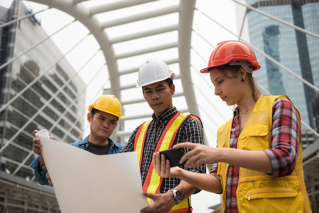 Construction team check plan in city