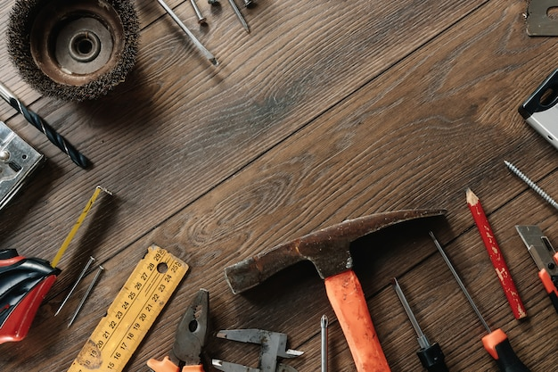 A construction tool on a brown wooden . view from above. picture , screensaver.  construction, repair, construction, production, . copyspace.