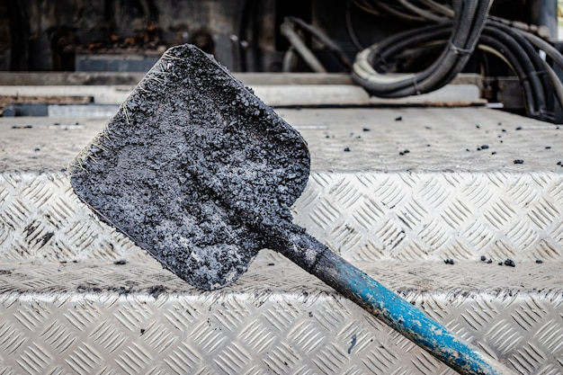 Construction tool for road works. shovel for laying asphalt close-up. asphalting of roads.