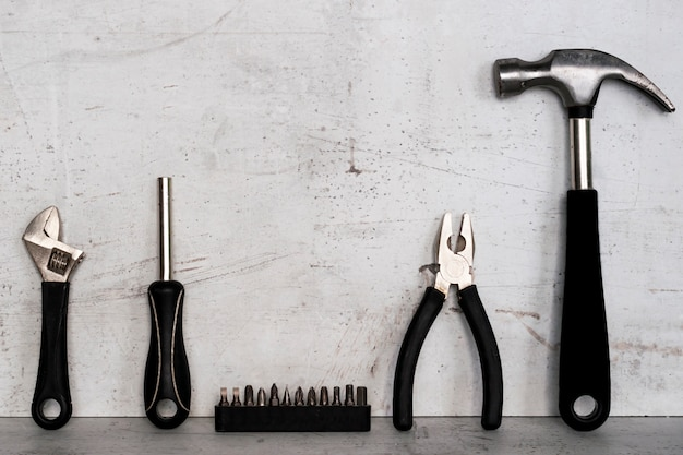 Construction tools are located on a light concrete background.