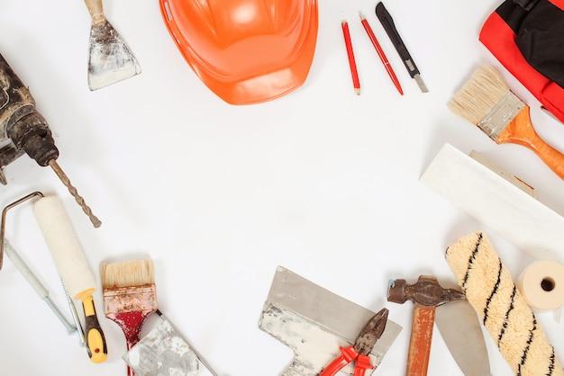構築ツール。家と家の改修の背景。汚れたbuiderツールのセットです。便利屋設備。