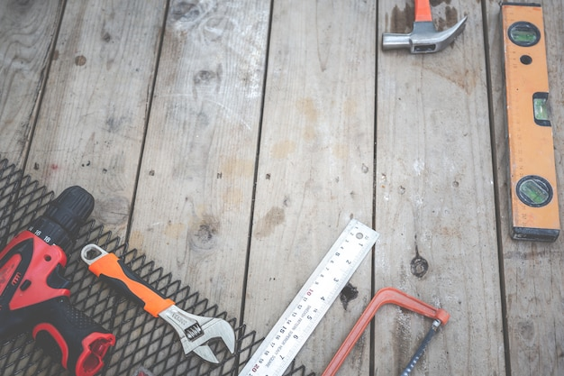 Construction tools placed on wooden floors.