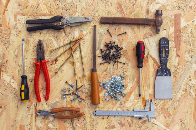 Construction tools: pliers, hammer, shears, screwdriver, pliers