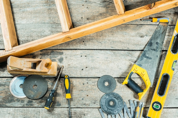 Construction tools for repairing on old wooden background