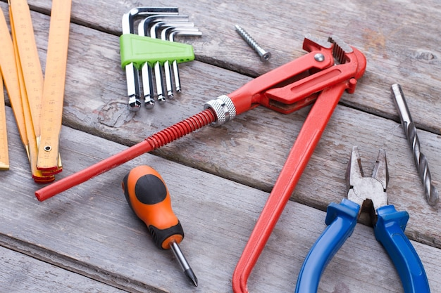 Construction tools on rustic wooden background