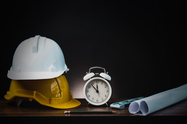 Construction tools with helmet on dark background