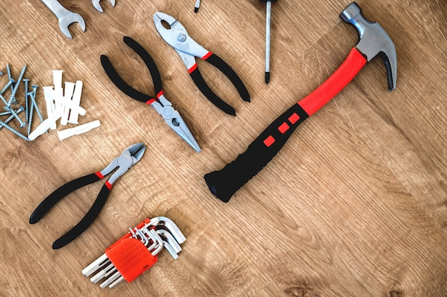 Construction tools on the wooden background.