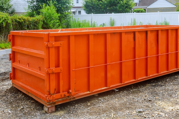 Construction trash dumpsters in an metal container, home house renovation.