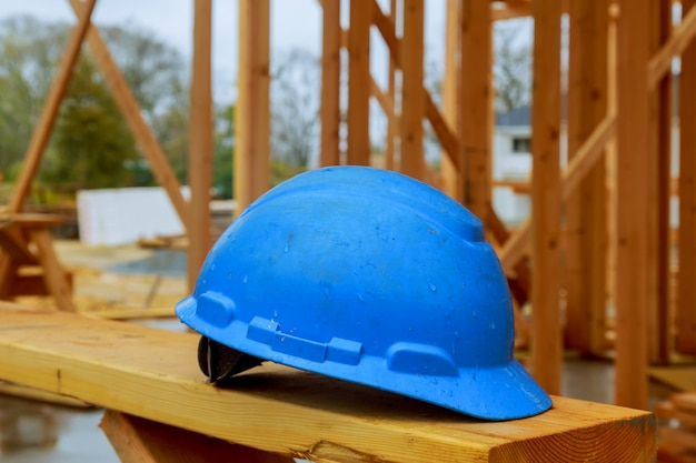 Construction work safety helmets for professional builders are placed on wooden boards