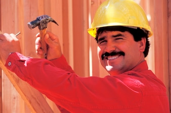 Construction worker building house