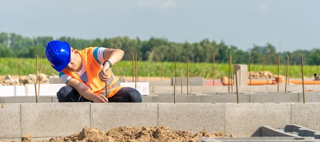 The construction worker builds the foundation of the building.