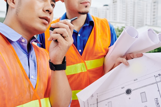 Construction worker controlling work