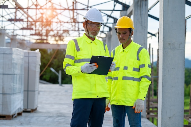 Construction worker discussing project details at building site