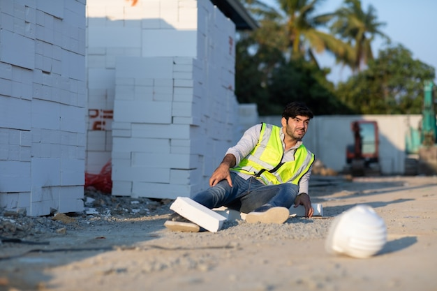 Construction worker has an accident lying on the floor while working in construction site  accident at work