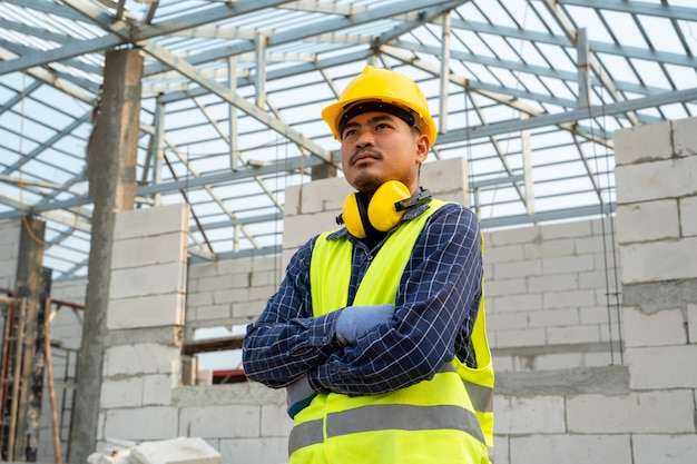 Construction worker in new house,house construction concept.