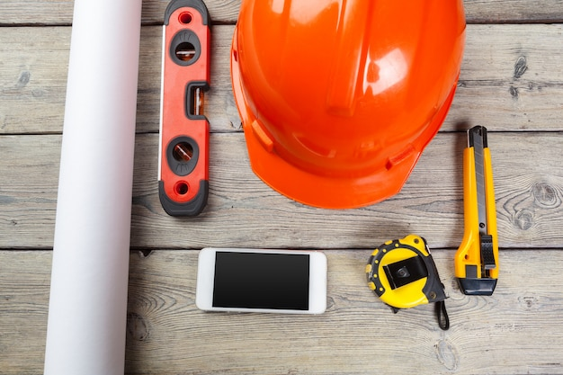 Construction  worker supplies and instruments on wooden table