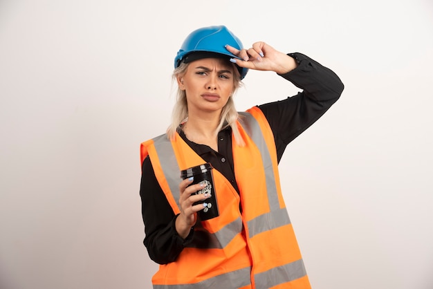 Construction worker with cup of tea feeling sad. high quality photo