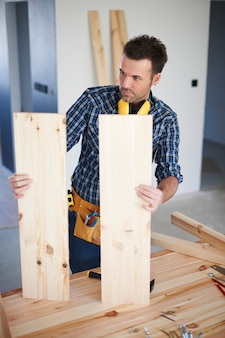 Construction worker with wooden boards