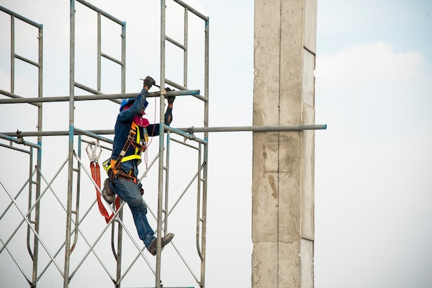 Construction worker working on scaffolding in construction site