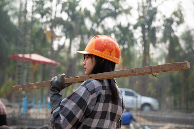 Construction workers build new houses
