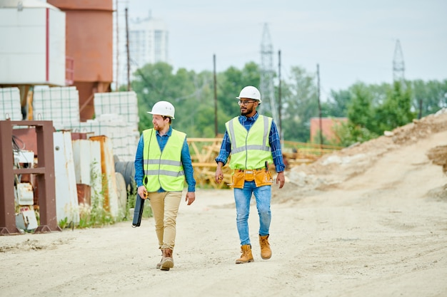 Construction workers crossing site