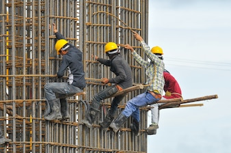 Construction workers tying steel