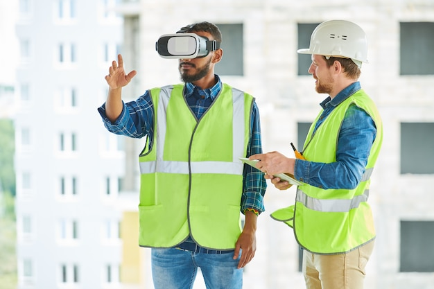 Construction workers using visual simulator on site