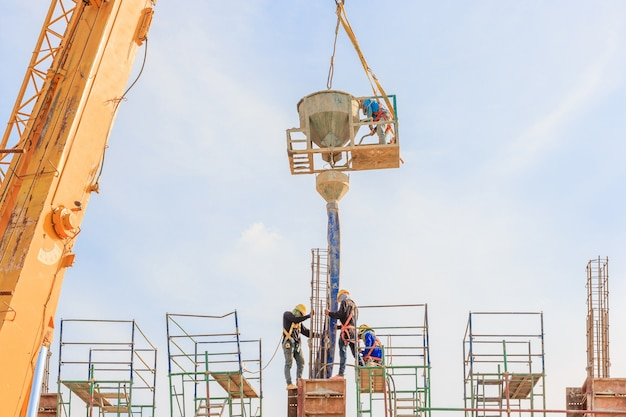Construction workers working on scaffolding at a high level