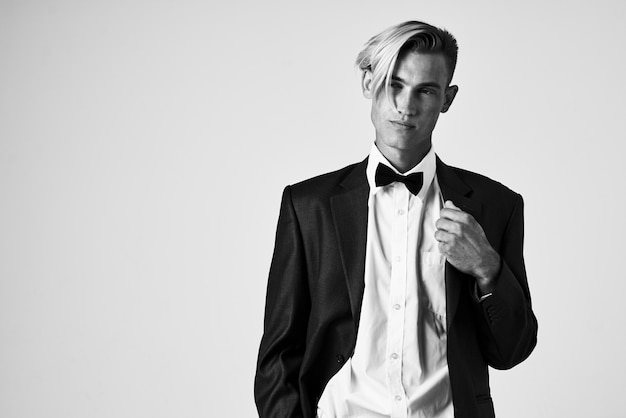 Consumable hairstyles in a black jacket bow tie model studio