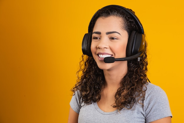 Contact the call center service. customer support, female sales agent. caller or operator of telephone operator or business woman in headset. afro young woman. zoom conference. yellow  background