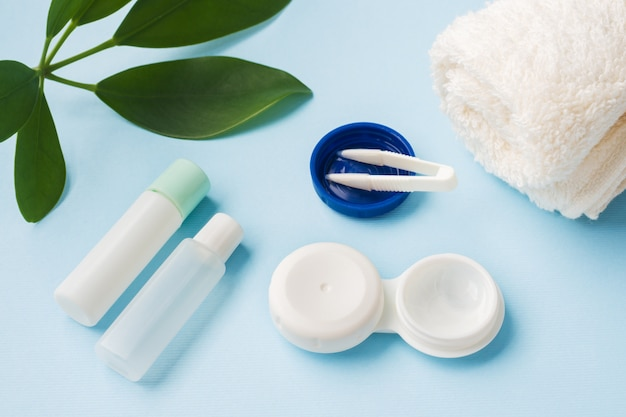 Contact lenses, tweezers and a container for storing lenses