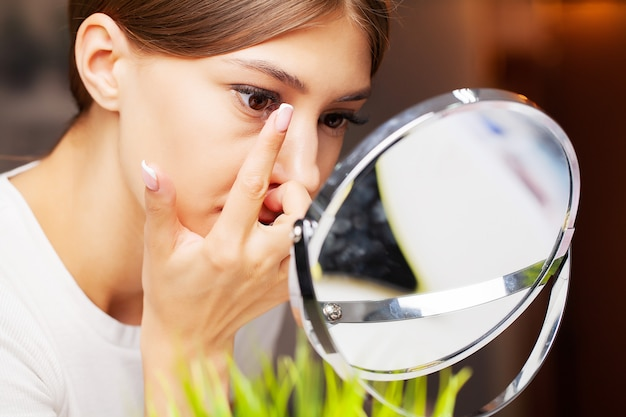 Contact lenses for vision. close up of woman applying contact lenses