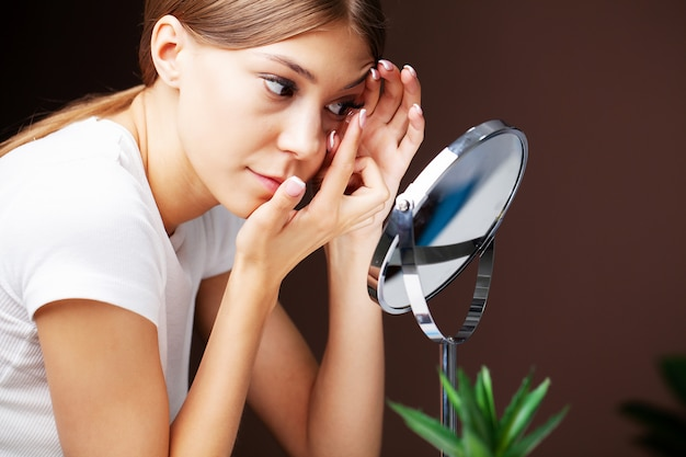 Contact lenses for vision. young woman applies contact lenses