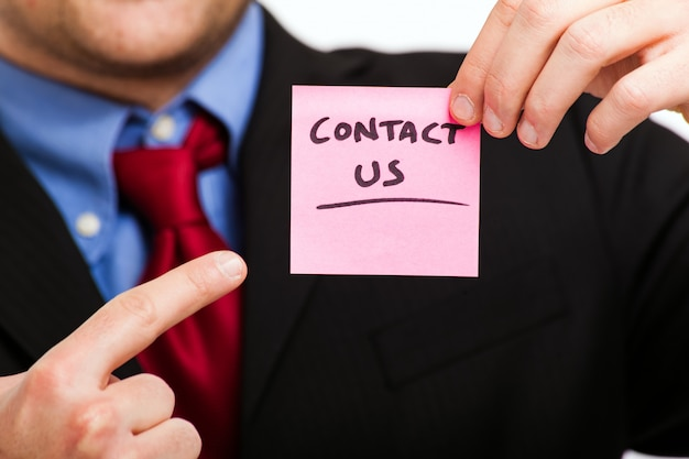 Contact us concept, businessman holding a sticker