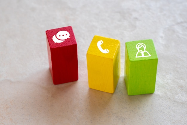 Contact us icon on colorful puzzle with hand